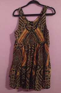 This gorgeous black and brown babydoll dress is great for many occassions. It can be worn as a casual summer dress with gladiator sandals or even dressed up for a nice dinner with the right jewelry. It is very comfortable and the best part: it's lined! So there's no need to worry about it being see through. This dress can be found at Melrose in the O.C. (www.melroseintheoc.com). They only have one location but their online site is just as amazing.